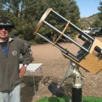 Bob Pfaff poses with his handmade 12.5-inch Schimdt Cassegrain telescope.