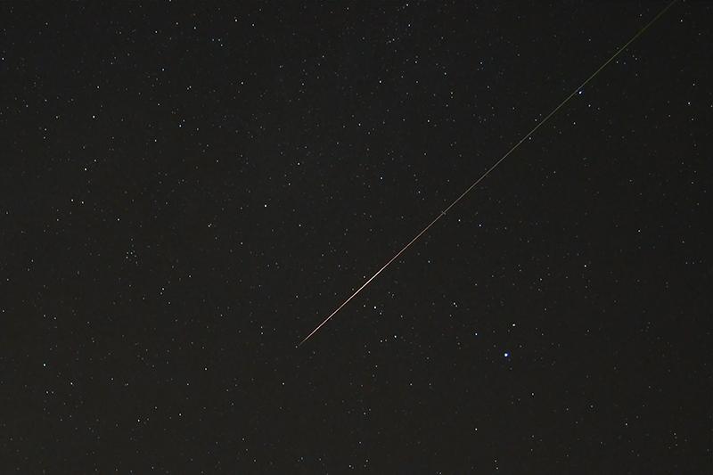Meteor streak against star field