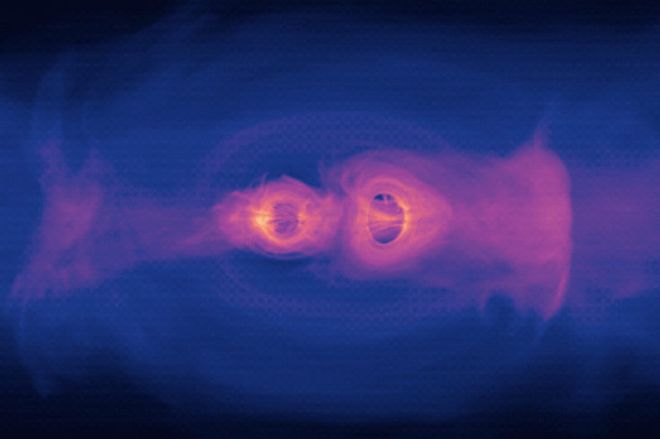 Still from simulation of two supermassive black holes merging