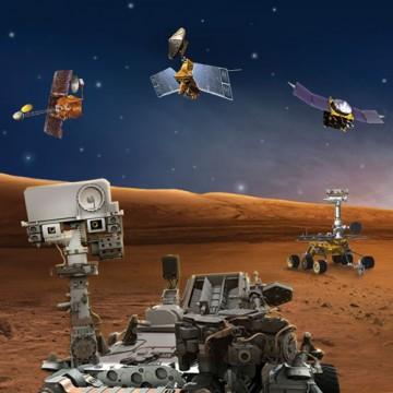 Artist's rendering of NASA's five robotic Mars explorers NASA