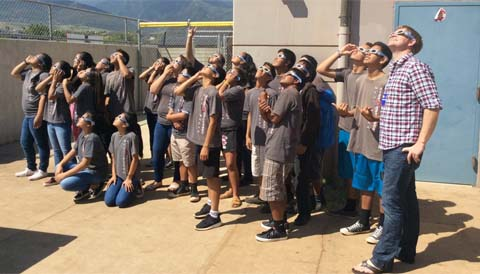 Students watching a solar eclipse