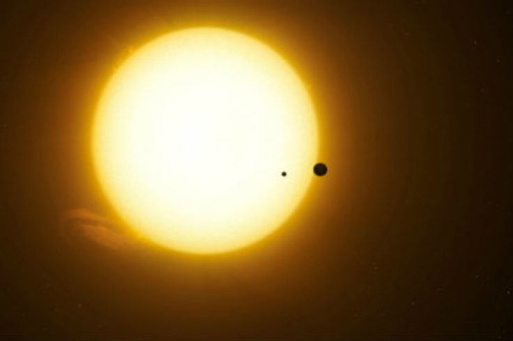 Illustration of Kepler-1625b and exomoon in transit