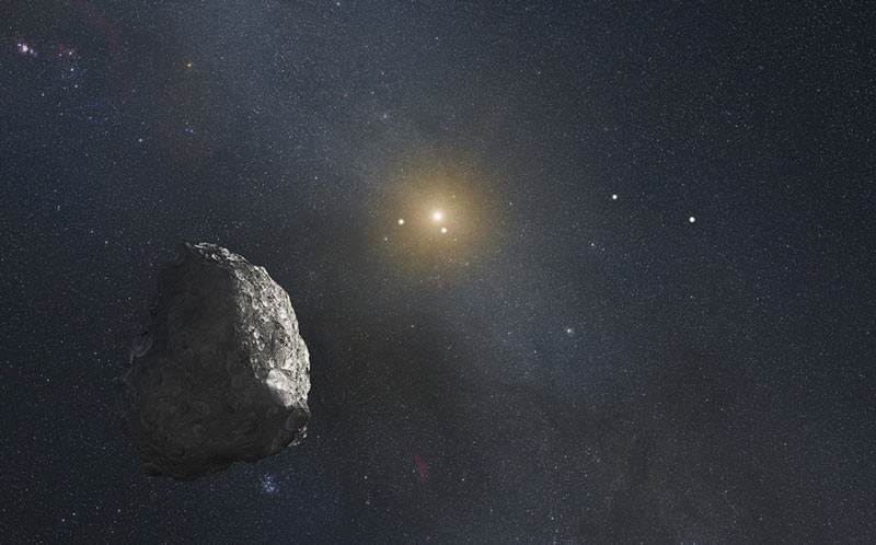 an asteroid like object floats through space with a bright star in the background