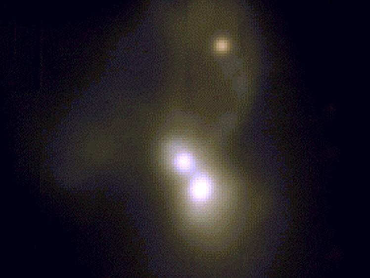 three bright points represent three merging galaxies