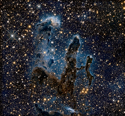 """The """"Pillars of Creation"""" inside the Eagle Nebula (M16) seen in the infrared. Our solar system likely formed inside a very similar stellar cocoon. NASA/ESA/STScl/AURA/Hubble Heritage Team."""